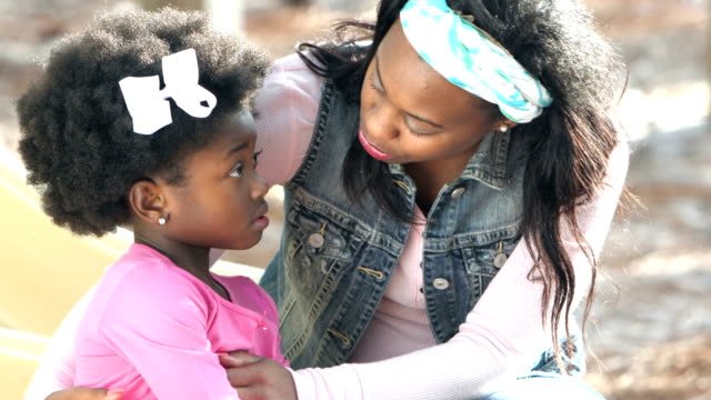 african-american mother consoling little girl - genitori video stock e b–roll