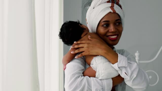 african-american mother holding her newborn baby boy(2 months) - nigeria video stock e b–roll