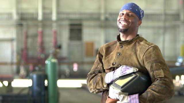 African-American welder in metal fabrication shop