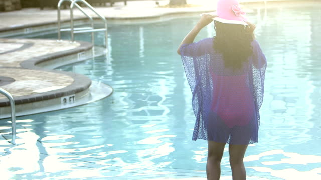 African-American woman dances in shallow end of pool video
