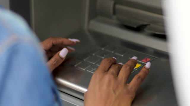 african-american woman using atm - banks and atms stock videos & royalty-free footage