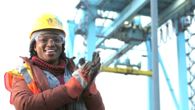 African-American woman working at seaport, smiling video