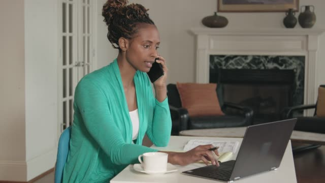 African-American Woman Working from Home Office video