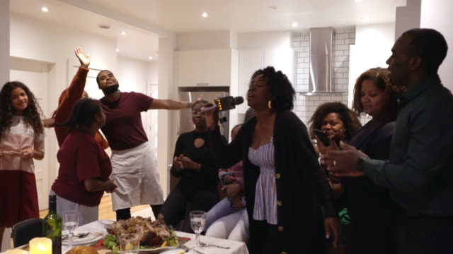 Afro american large family karaoke diner for thanksgiving multi generations