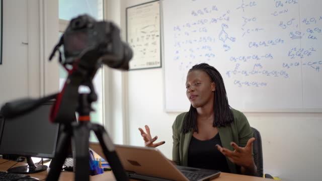 Afro american woman, female teacher standing near whiteboard