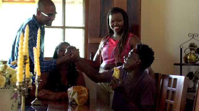 afro family eating panettone - panettone video stock e b–roll