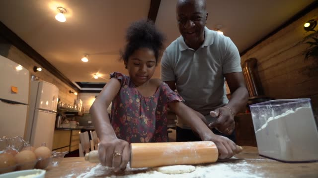 Afro father teaching his daughter how to cook at home Domestic Life cooking utensil stock videos & royalty-free footage