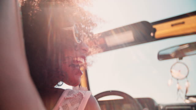 Afro girl on summer vacation road trip in Slow Motion video
