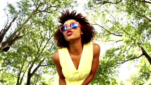 Afro Girl with sunglasses in park video