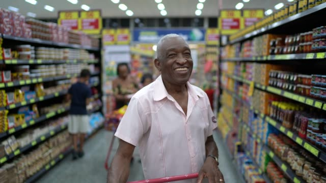 afro hispanic latino senior man portrait at supermarket - spanish and portuguese ethnicity stock videos & royalty-free footage