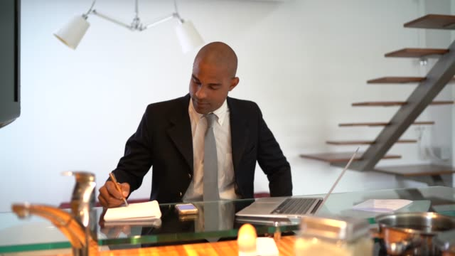 Afro latino businessman working on a laptop at home office