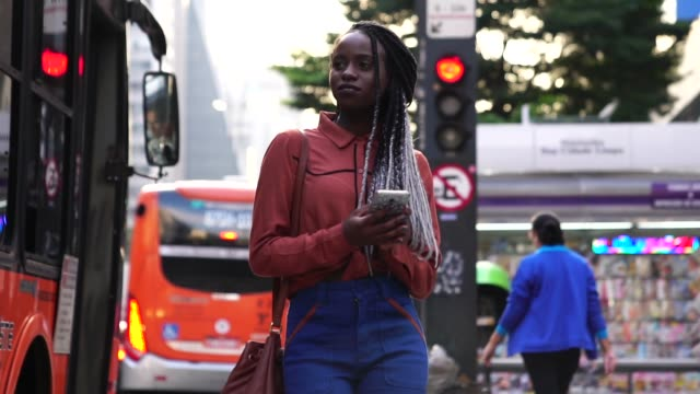 Afro Woman Walking and Using Mobile at City Busy Life locs hairstyle stock videos & royalty-free footage