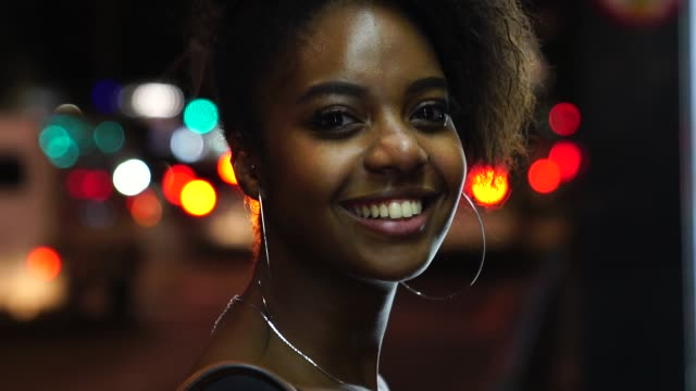 Afro young woman portrait in the city at night Follow me puerto rico stock videos & royalty-free footage