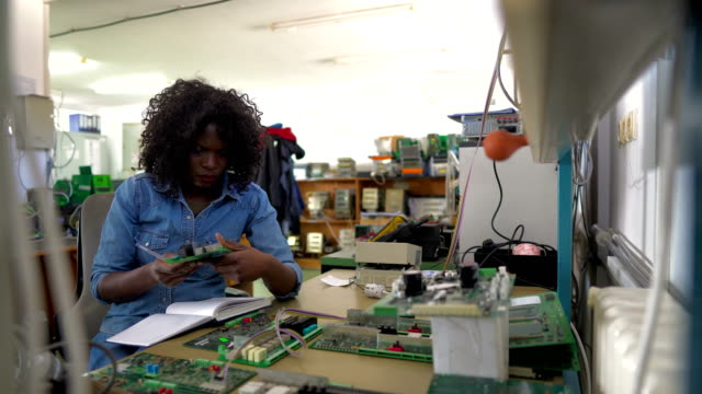 Afro-American female technician at work