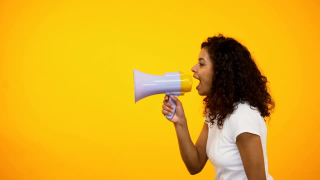 Afro-American girl screaming in megaphone, spreading information, awareness Afro-American girl screaming in megaphone, spreading information, awareness megaphone stock videos & royalty-free footage