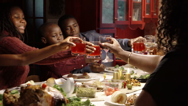 Afro-american large family thanksgiving dinner Home