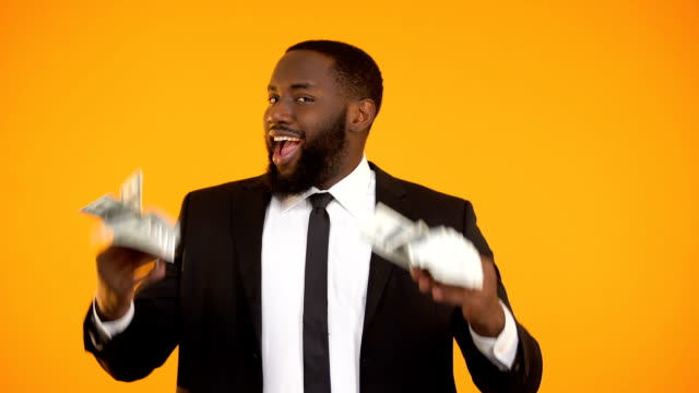 Afro-american male in formal suit making dancing movements with dollar cash Afro-american male in formal suit making dancing movements with dollar cash salesman stock videos & royalty-free footage