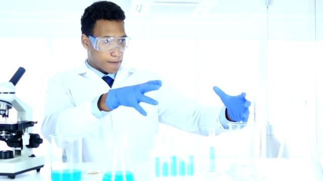 Afro-American Scientist imaginating New idea in Laboratory video