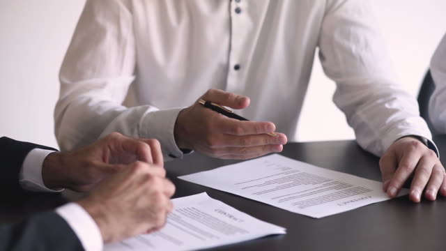 After consideration clauses of contract parties signing agreement closeup view