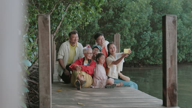 After retirement, enjoy traveling mangrove forest with large family-stock video video