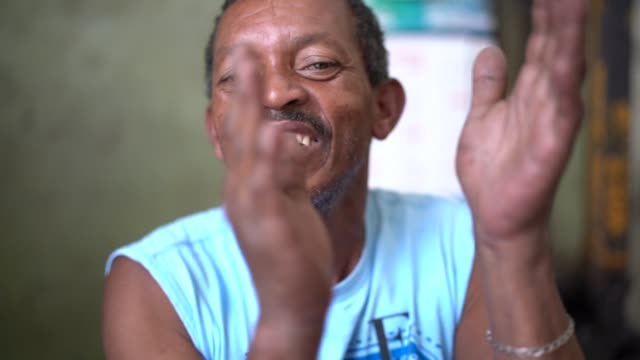 Aged Man Singing and Playing Samba with Hands video