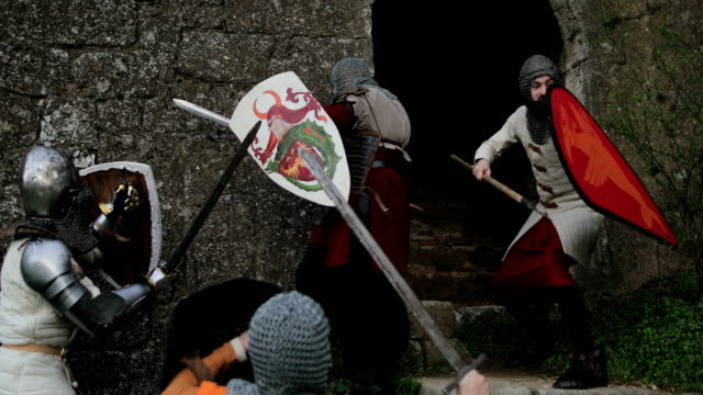 aggressive medieval knights attack the guard - битва стоковые видео и кадры b-roll
