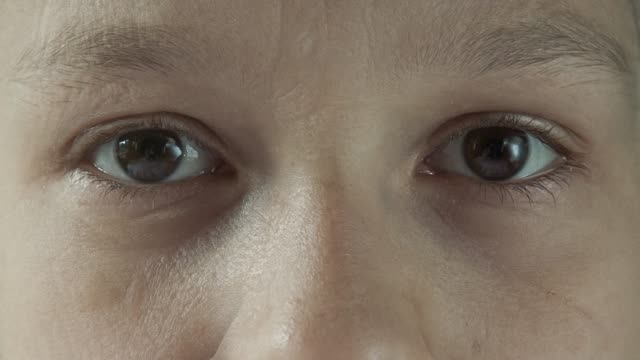 aging timelapse closeup. young girl changeing into grandmother. - morphing video stock e b–roll