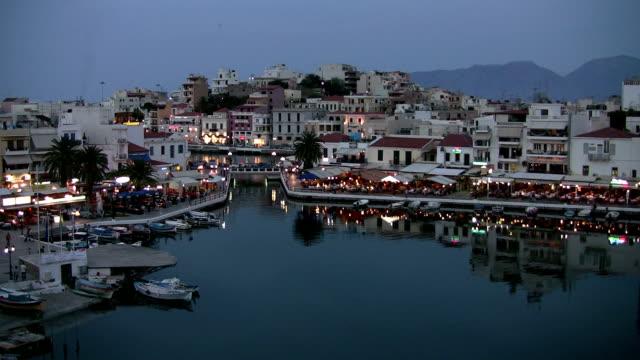 Agios Nikolaos Harbor, Crete, Greece at Dusk video