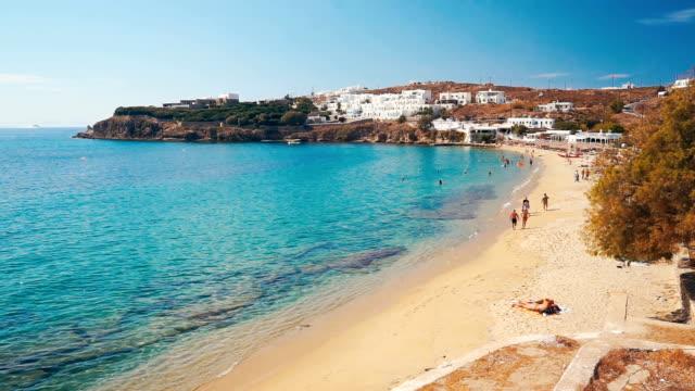 agios stefanos beach of mykonos island, grekland. - grekland bildbanksvideor och videomaterial från bakom kulisserna