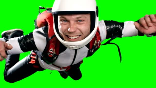 agitated man parachuting first time - скайдайвинг стоковые видео и кадры b-roll