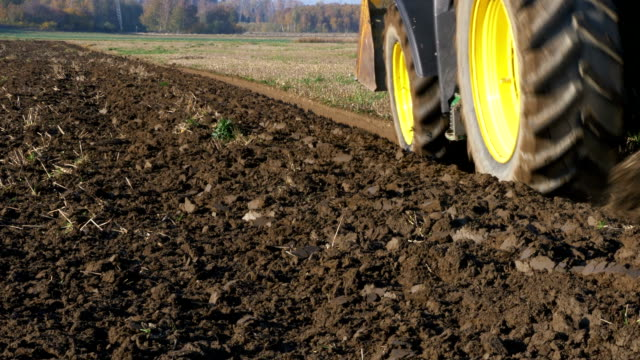 Agricultural tractor plowing the field Agricultural tractor plowing the field plow stock videos & royalty-free footage