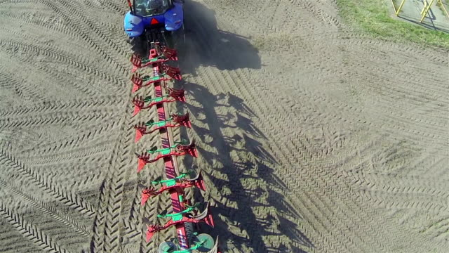 Agricultural tractor with  plow. Aerial top video