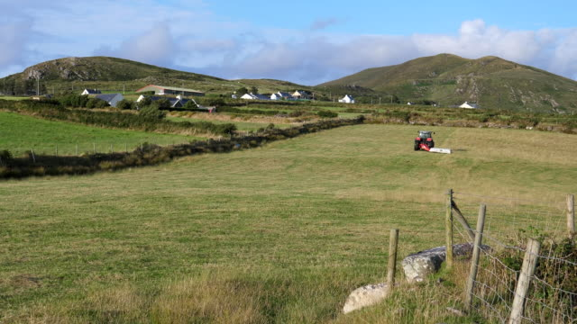 Bидео Agriculture in Ireland. Tractor cutting grass
