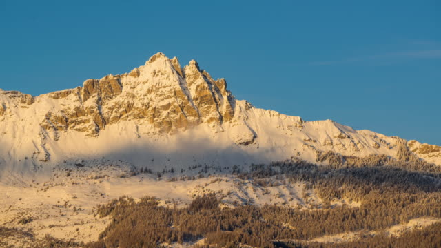 Aiguilles de Chabrieres in Winter between sunset and twilight (timelapse). Ecrins National Park, Hautes-Alpes, Alps, France - vídeo