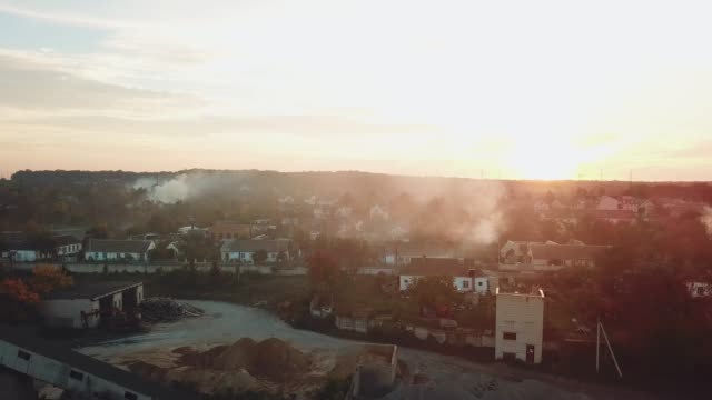 air above the city is filled with smoke after a fire from drought on the background of sunset. air above the city is filled with smoke after a fire from drought on the background of sunset. Aerial view heat haze stock videos & royalty-free footage