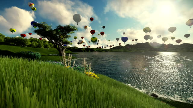 Air balloons flying over beautiful lake and green meadow surrounded by mountains video
