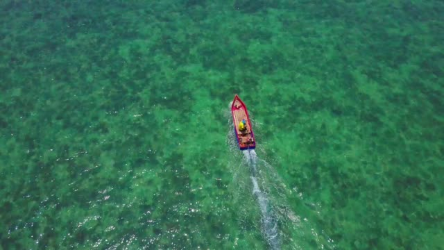 air flight over a fishing boat in the sea - phuket video stock e b–roll