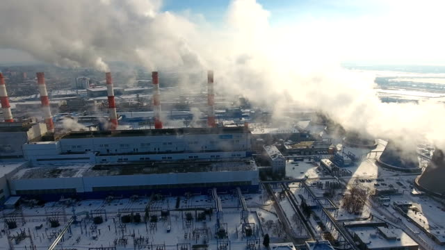 Air pollution concept. Power plant with smoke from chimneys. Drone shot. video