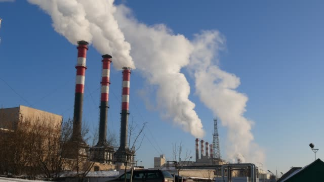 Air Pollution From Industrial Plants. Smoking industrial pipes. Red with white pipe.