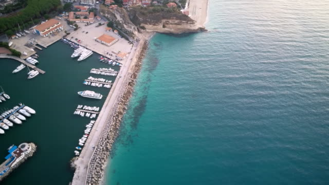 air view of the bay where the yachts and ships are moored. - video di tropea video stock e b–roll
