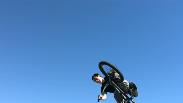 BMX air with blue sky , slow motion video