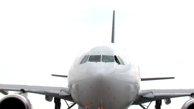 Airbus A330 Jet Airplane Pushback seq Airbus A330 Airplane Pushing back from the gate, sequence of two shots multiple image stock videos & royalty-free footage
