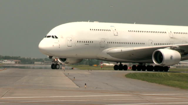 Airbus A380 Airplane taxiing in from the Runway video