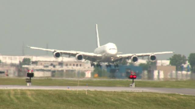 AirbusA380 SuperJumbo Jet Airplane Landing Closeup on a hot day video