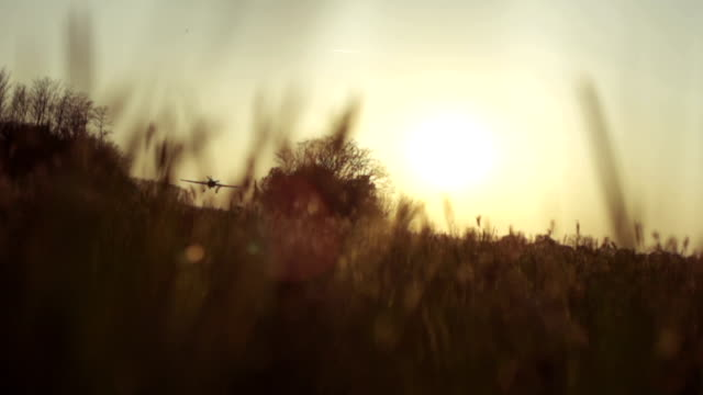 SLOW MOTION: Aircraft ascending at sunset video