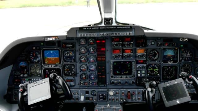 aircraft cockpit of piaggio p180 avanti turboprop airplane - {{relatedsearchurl(carousel.phrase)}} video stock e b–roll