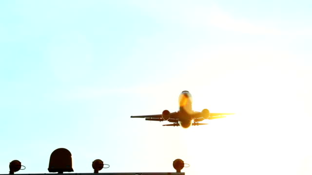 Aircraft directly above camera daytime through sun rays