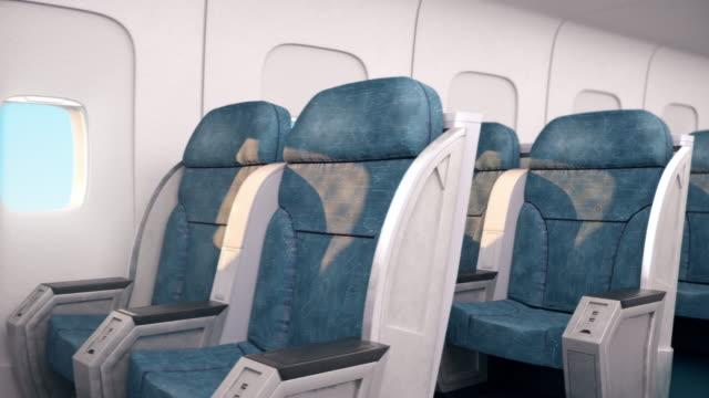 현관과 의자 좌석이있는 항공기 실내 캐빈은 통과자가없습니다. - airplane seat 스톡 비디오 및 b-롤 화면