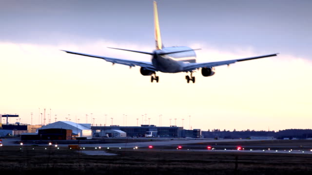 Aircraft landing at dusk Aircraft landing at dusk airfield stock videos & royalty-free footage