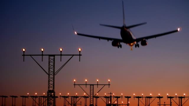 Aircraft landing at dusk video